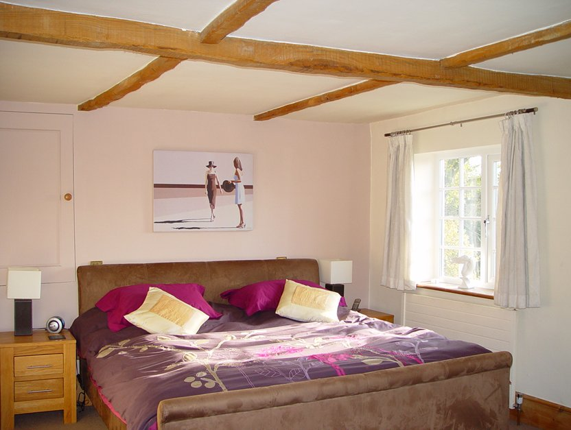 Triple aspect bedroom with dressing room and en suite bathroom
