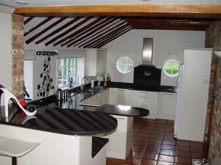 Fully equipped kitchen overlooking garden/patio